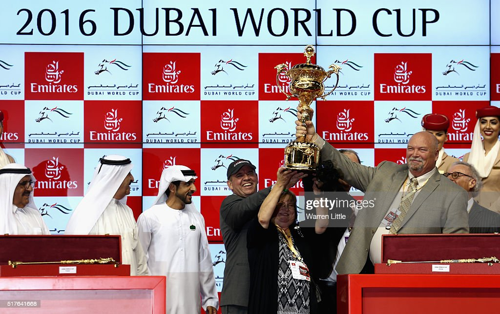 Sheikh Hamdan bin Mohammed bin Rashid Al Maktoum presents the World Cup to the team of California Chrome after winning the Dubai World Cup Sponsored By Emirates Airline as part of the Dubai World Cup at the Meydan Racecourse on March 26, 2016 in Dubai, United Arab Emirates.