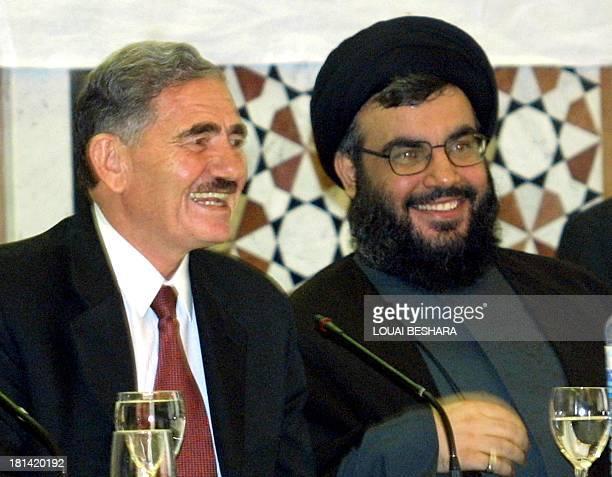 Sheikh Hasan Nasrallah Secretary General of the Hezbollah shares a light moment with Abdullah alAhmar deputy Secretary General of the Syrian ruling...