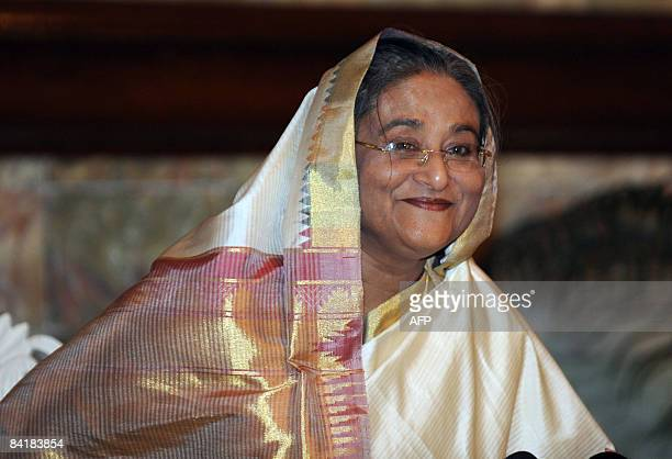 Sheikh Hasina Wajed smiles after being sworn in for her second spell as prime minister of Bangladesh at the presidential palace in Dhaka on January 6...