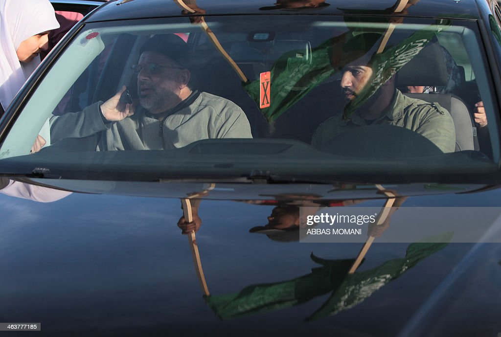 Sheikh Hassan Yousef (L), a prominent leader of the Hamas Islamic movement, is seen leaving Israel's Ofer prison, near the West Bank city of Ramallah following his release on January 19, 2014 after spending 28 months in prison, near the West Bank city of Ramallah. Yousef, who is also a member of the Ramallah-based Palestinian Legislative Council, told reporters after being released that he would work with Hamas rivals 'Fatah and other Palestinian factions to achieve reconciliation.'