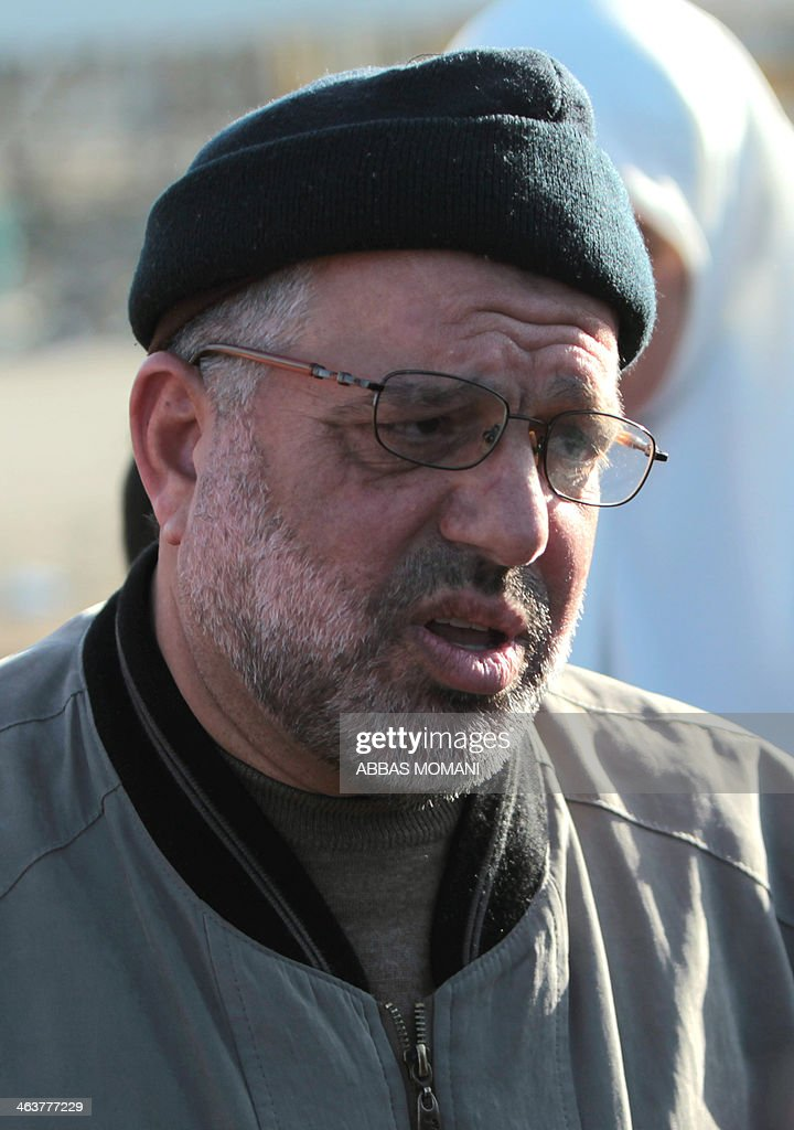 Sheikh Hassan Yousef (L), a prominent leader of the Hamas Islamic movement, is seen following his release from Israel's Ofer prison, near the West Bank city of Ramallah following his release on January 19, 2014 after spending 28 months in prison, near the West Bank city of Ramallah. Yousef, who is also a member of the Ramallah-based Palestinian Legislative Council, told reporters after being released that he would work with Hamas rivals 'Fatah and other Palestinian factions to achieve reconciliation.'