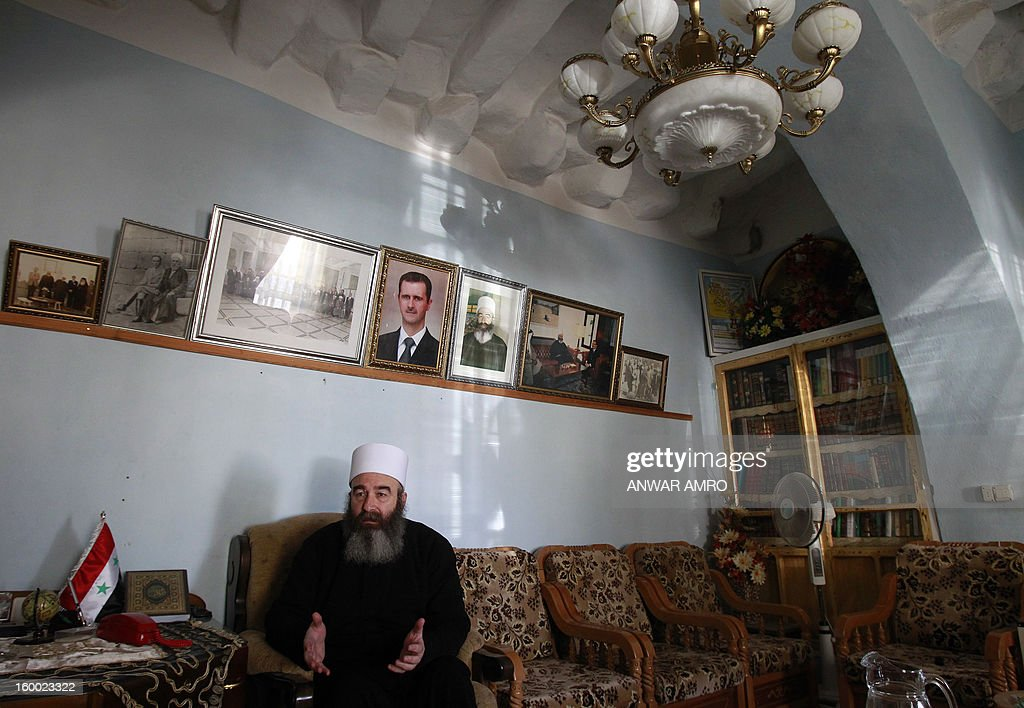 Sheikh Hikmat Hajari, a top Druze cleric, sits in his home in the southern city of Sweida on January 23, 2013. Abductions of Druze officials in Daraa were rampant in May and June of last year, prompting the inhabitants of Sweida to respond in kind, leaving behind a palpable distrust between the provinces, though Sweida hosts some 9,000 displaced people of Daraa.