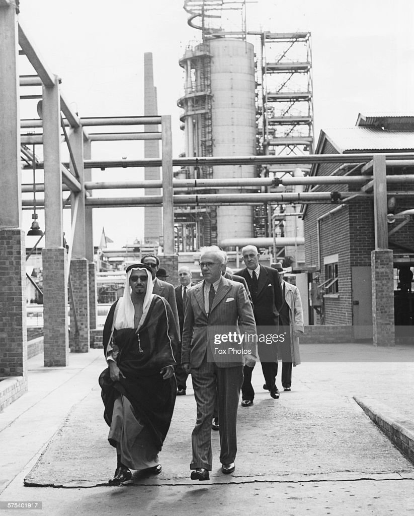Sheikh Jaber Al Ahmad Al Sabah of Kuwait walking with a group of officials during an inspection of the Isle of Grain Oil Refinery England July 7th...