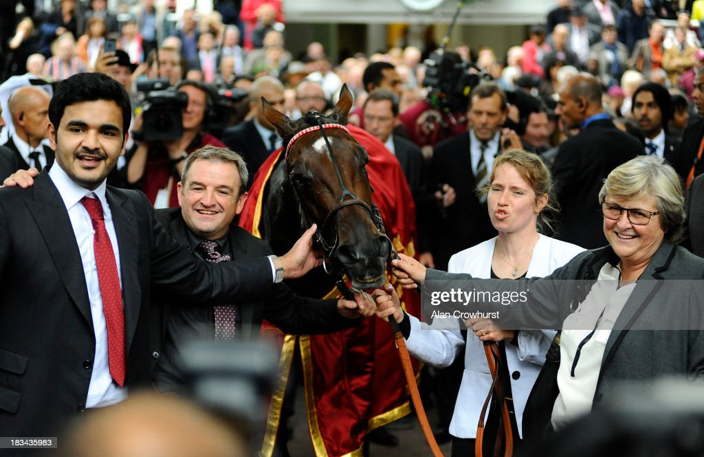 Sheikh Joaan Al Thani (L) owner of Treve and trainer Criquette Head-Maarek (R) pose after winning The Qatar Prix de l'Arc de Triomphe at Longchamp racecourse on October 06, 2013 in Paris, France.