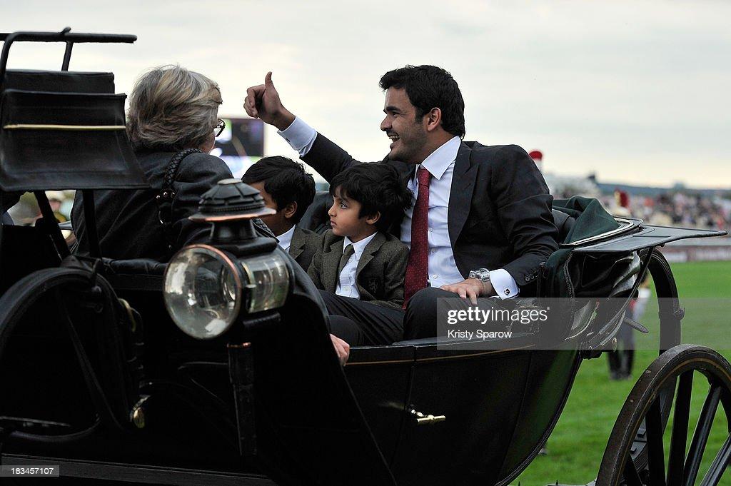 Sheikh Joaan Al Thani (R) owner of Treve arrives to except his 1st place trophie after winning The Qatar Prix de l'Arc de Triomphe at Hippodrome de Longchamp on October 6, 2013 in Paris, France.
