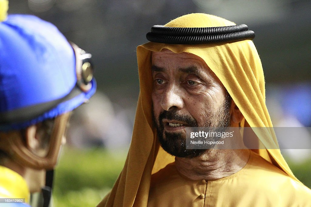 Sheikh Khalifa Al Maktoum talks to jockey <a gi-track='captionPersonalityLinkClicked' href=/galleries/search?phrase=Christophe+Soumillon&family=editorial&specificpeople=453308 ng-click='$event.stopPropagation()'>Christophe Soumillon</a> during Super Saturday at Meydan Racecourse on March 9, 2013 in Dubai, United Arab Emirates.