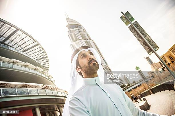 Sheikh looking to Dubai downtown skyscrapers and office buildings