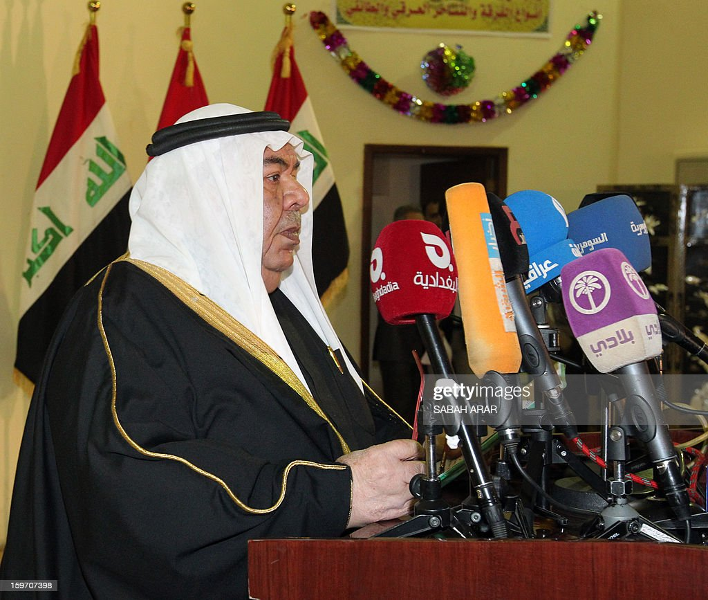 Sheikh Majid Ali Suleiman, head of the Sunni tribal confederation of Dulaim, speaks at a meeting of Sunni and Shiite clan leaders in Baghdad and attended by Iraqi Deputy Interior Minister Adnan al-Assadi, in an attempt to voice protestor demands and halt the escalation of demonstrations in Sunni areas, on January 19, 2013. AFP PHOTO / SABAH ARAR