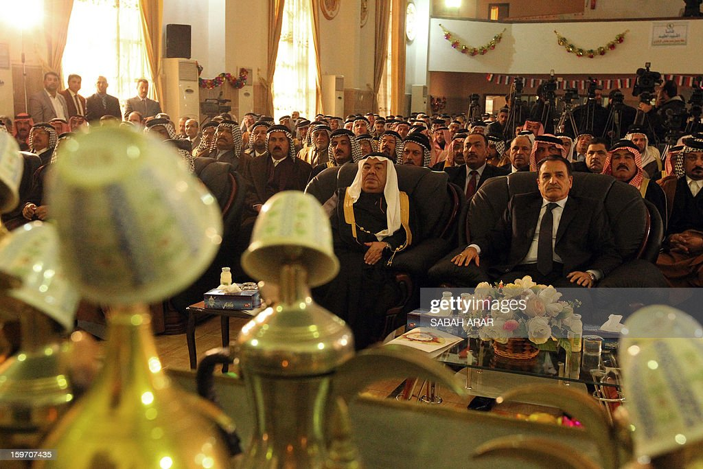 Sheikh Majid Ali Suleiman (C-L), head of the Sunni tribal confederation of Dulaim, and Iraqi Deputy Interior Minister Adnan al-Assadi (C-R), attend a meeting of Sunni and Shiite clan leaders in Baghdad in an attempt to voice protestor demands and halt the escalation of demonstrations in Sunni areas, on January 19, 2013.
