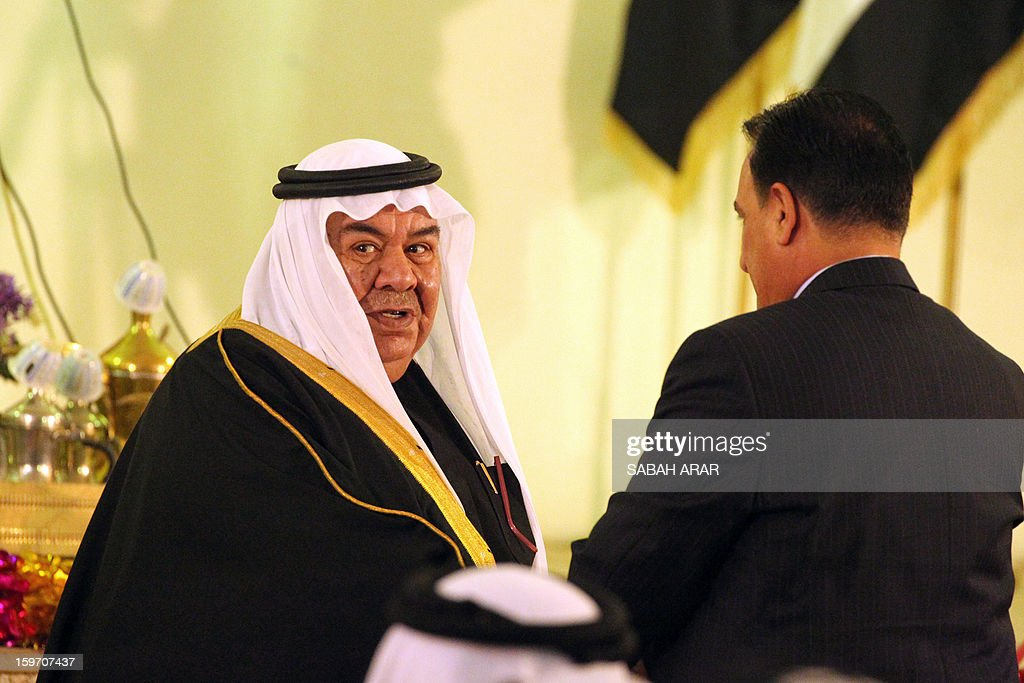 Sheikh Majid Ali Suleiman (L), head of the Sunni tribal confederation of Dulaim, speaks with Iraqi Deputy Interior Minister Adnan al-Assadi (R), at a meeting of Sunni and Shiite clan leaders in Baghdad in an attempt to voice protestor demands and halt the escalation of demonstrations in Sunni areas, on January 19, 2013. AFP PHOTO / SABAH ARAR