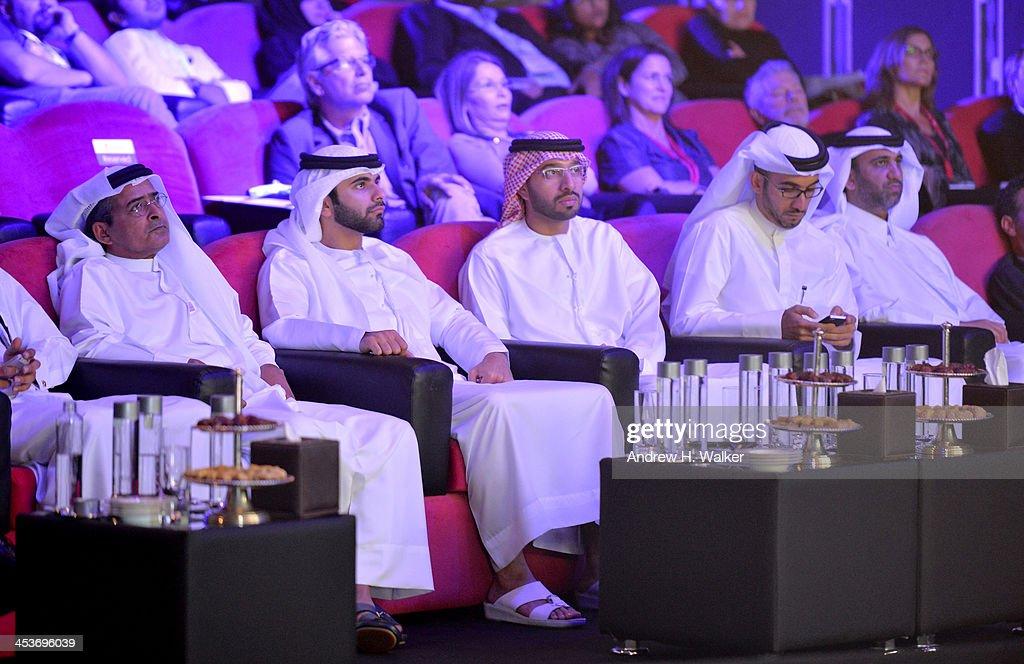 Sheikh Mansoor bin Mohammed bin Rashid Al Maktoum (second left), DIFF Chairman Abdulhamid Juma (left) and guests attend the Cinematic Innovation Summit ahead of the 10th Annual Dubai International Film Festival at Atlantis, The Palm Hotel on December 12, 2013 in Dubai, United Arab Emirates.