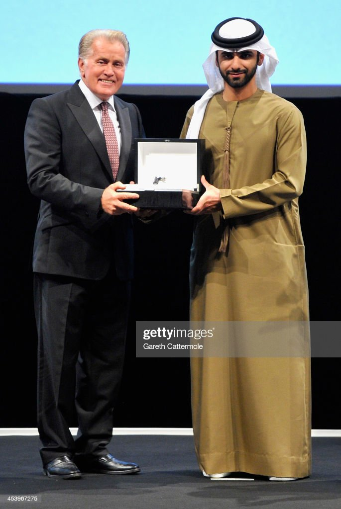 Sheikh Mansoor bin Mohammed bin Rashid Al Maktoum presents <a gi-track='captionPersonalityLinkClicked' href=/galleries/search?phrase=Martin+Sheen&family=editorial&specificpeople=203224 ng-click='$event.stopPropagation()'>Martin Sheen</a> with his Lifetime Achievement award on stage at the Opening Night Gala of the 10th Annual Dubai International Film Festival held at the Madinat Jumeriah Complex on December 6, 2013 in Dubai, United Arab Emirates.
