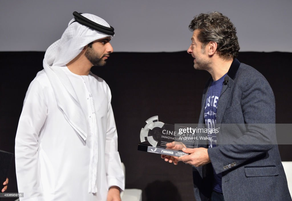 Sheikh Mansoor bin Mohammed bin Rashid Al Maktoum speaks with Andy Serkis after he presented him with the 2013 Cinematic Innovation award during the Cinematic Innovation Summit ahead of the 10th Annual Dubai International Film Festival at Atlantis, The Palm Hotel on December 12, 2013 in Dubai, United Arab Emirates.