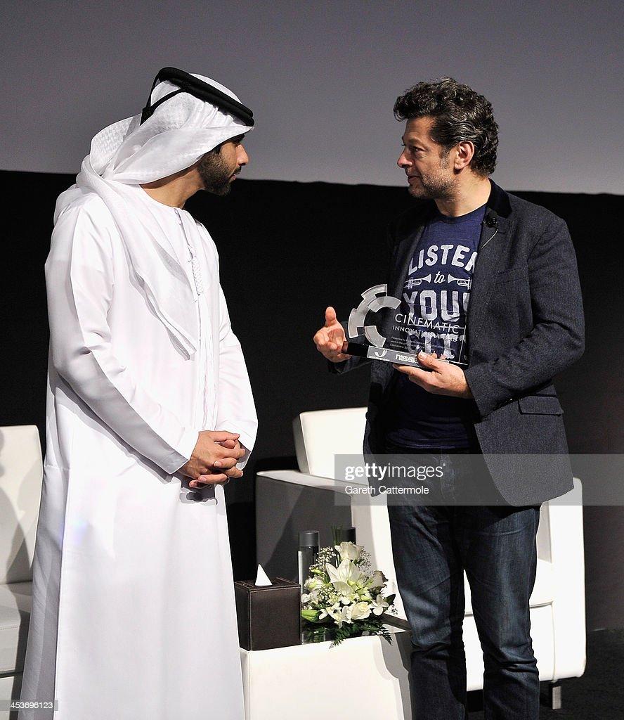 Sheikh Mansoor bin Mohammed bin Rashid Al Maktoum speaks with Andy Serkis after he presented him with the 2013 Cinematic Innovation award during the Cinematic Innovation Summit ahead of the 10th Annual Dubai International Film Festival at Atlantis, The Palm Hotel on December 12, 2013 in Dubai, United Arab Emirates.
