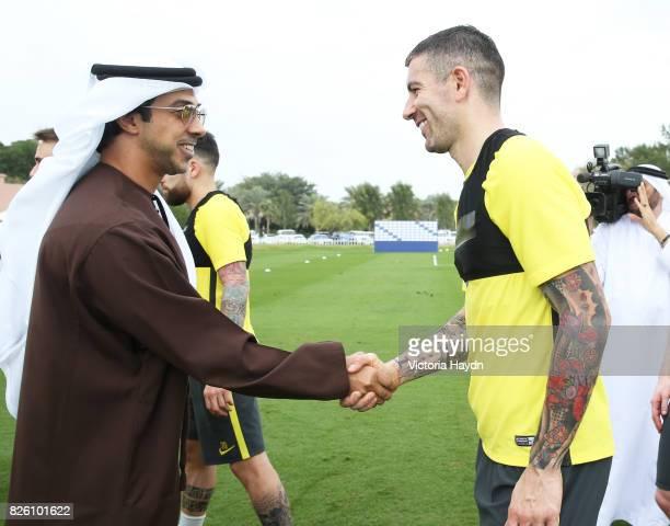 HH Sheikh Mansour speaks with Aleksandar Kolarov during their mid season training camp in Abu Dhabi