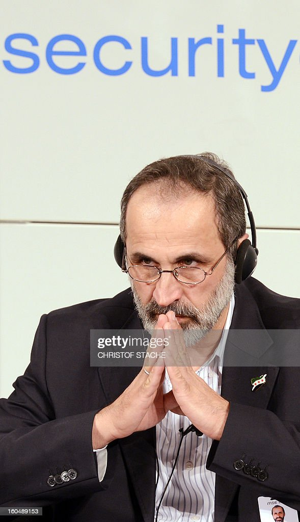 Sheikh Moaz Al-Khatib, head of the Syrian oposition, listens during the Munich Security Conference on February 1, 2013 in Munich, southern Germany. High-level officials, ministers and top military brass gathered at the Munich Security Conference Friday with Syria in the spotlight and amid a US warning to Iran over stalled nuclear talks.