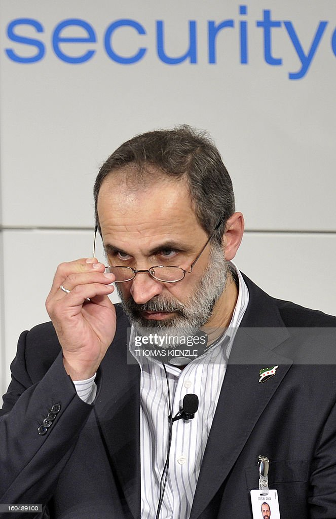 Sheikh Moaz Al-Khatib, head of the Syrian oposition, talks during the Munich Security Conference on February 1, 2013 in Munich, southern Germany. High-level officials, ministers and top military brass gathered at the Munich Security Conference Friday with Syria in the spotlight and amid a US warning to Iran over stalled nuclear talks.
