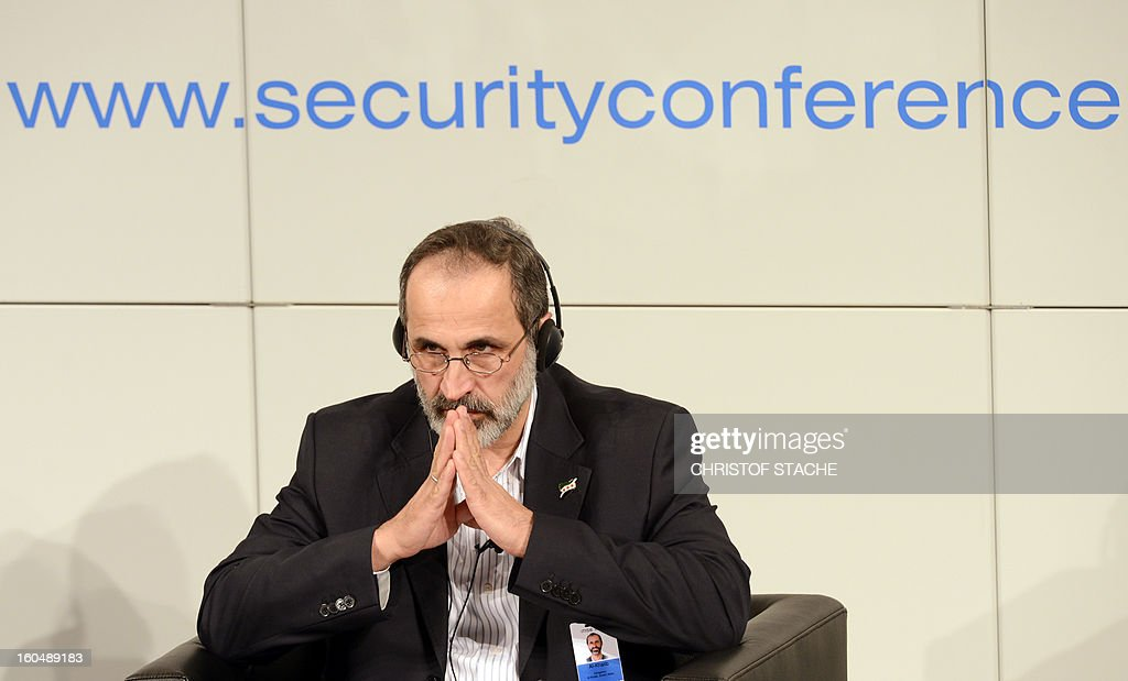 Sheikh Moaz Al-Khatib, head of the Syrian opposition, listens during the Munich Security Conference on February 1, 2013 in Munich, southern Germany. High-level officials, ministers and top military brass gathered at the Munich Security Conference Friday with Syria in the spotlight and amid a US warning to Iran over stalled nuclear talks.