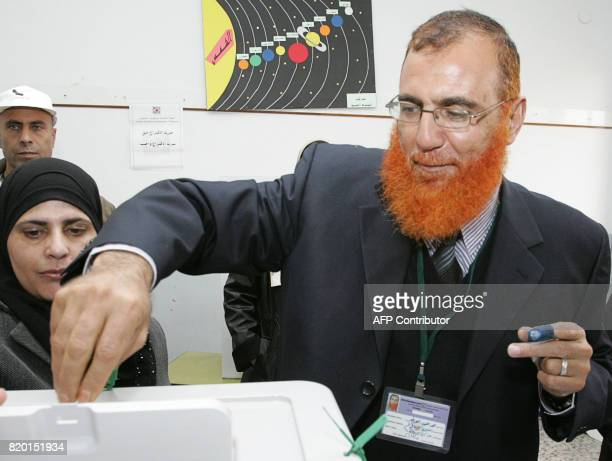 Sheikh Mohammed Abu Tir a Hamas candidate and a Palestinian resident of Arab east Jerusalem casts his ballot at a polling station in Jabel Mukabir a...