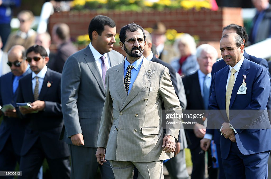 Sheikh <a gi-track='captionPersonalityLinkClicked' href=/galleries/search?phrase=Mohammed+Bin+Rashid+Al+Maktoum&family=editorial&specificpeople=658741 ng-click='$event.stopPropagation()'>Mohammed Bin Rashid Al Maktoum</a> and his entourage at Newmarket racecourse on September 27, 2013 in Newmarket, England.