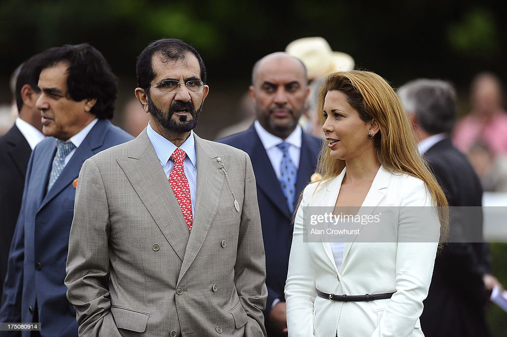 Sheikh Mohammed bin Rashid Al Maktoum and Princess Haya of Jordan are seen at Goodwood racecourse on July 31, 2013 in Chichester, England.