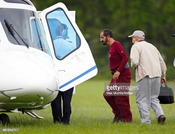 Sheikh Mohammed bin Rashid Al Maktoum boards a helicopter as he leaves the Royal Windsor Endurance event on day 3 of the Royal Windsor Horse Show in...