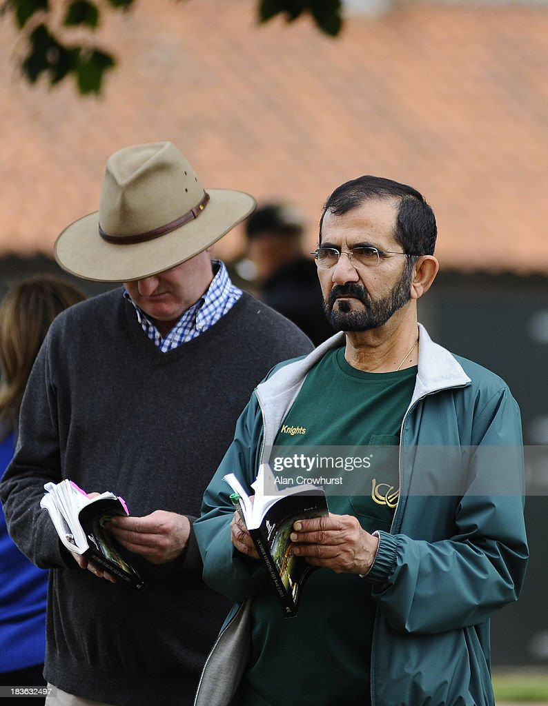 Sheikh Mohammed bin Rashid Al Maktoum looks at lot 52 at Tattersalls yearling sales on October 08, 2013 in Newmarket, England.