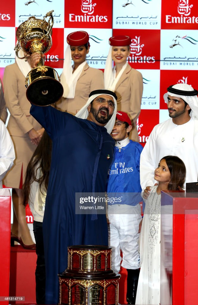 Sheikh Mohammed bin Rashid Al Maktoum, Ruler of Dubai and Vice President of the UAE rejoices after winning the Dubai World Cup with his horse African Story ridden by Silvestre De Sousa at the Meydan Racecourse on March 29, 2014 in Dubai, United Arab Emirates.