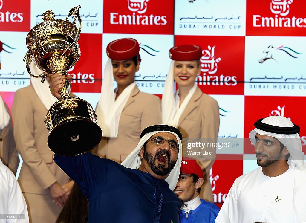Sheikh Mohammed bin Rashid Al Maktoum, Ruler of Dubai and Vice President of the UAE rejoices as he wins the Dubai World Cup with his horse African Story ridden by Silvestre De Sousa at the Meydan Racecourse on March 29, 2014 in Dubai, United Arab Emirates.