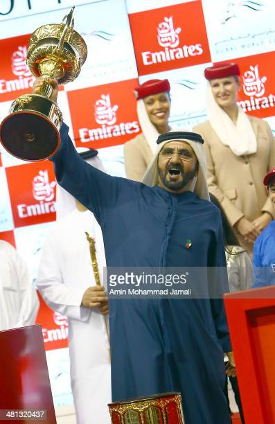 Sheikh Mohammed bin Rashid Al Maktoum Ruler of Dubai and Vice President of the UAE rejoices after winning the Dubai World Cup with his horse African...