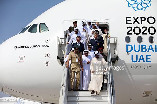 Sheikh Mohammed bin Rashid Al Maktoum the ruler of Dubai below right exits following a tour of an Airbus A380800 aircraft operated by Emirates...