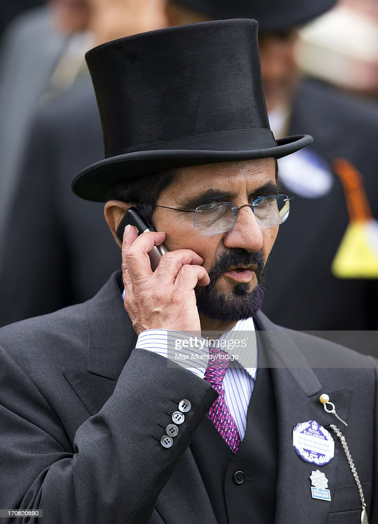 Sheikh Mohammed bin Rashid Al Maktoum uses a mobile telephone as he attends Day 1 of Royal Ascot at Ascot Racecourse on June 18, 2013 in Ascot, England.