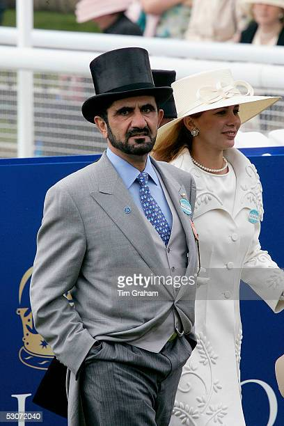 Sheikh Mohammed bin Rashid alMaktoum of Dubai wears traditional top hat and tails morning suit with Princess Haya of Jordan attends the second day of...