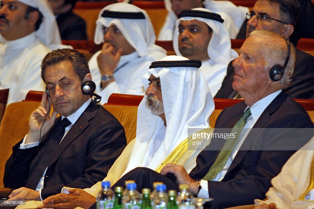 Sheikh Nahyan Bin Mubarak Al Nahyan ©, UAE Minister of Higher Education and Scientific Research, sits amidst former French president Nicolas Sarkozy (L) and former US secretary of state James Baker (R) as they attend the Global Financial Markets Forum at the Emirates Palace in Abu Dhabi on February 27, 2013.