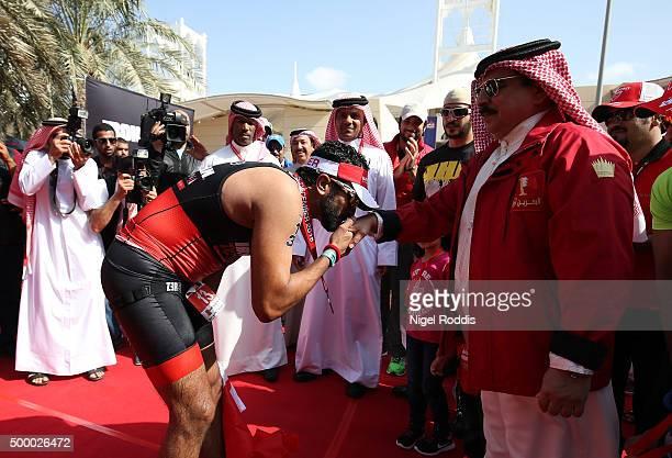 Sheikh Nasser Bin Hamad Al Khalifa of Bahrain is greeted by his father King of Bahrain Hamad bin Isa Al Khalifa after finishing Ironman Bahrain on...