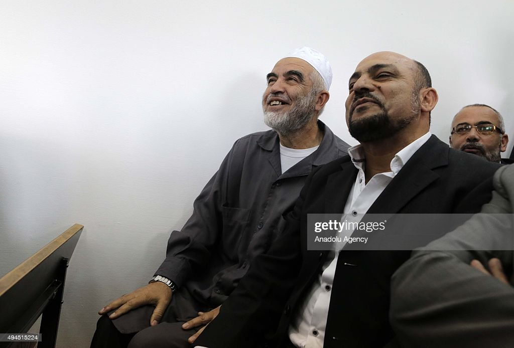 Sheikh Raed Salah (left), the leader of Islamic movement in the 1948 Palestine, and Masud Ghnaim (right), one of the Arab members of Knesset, attend a trial of Raed Salah at the Jerusalem Regional Court on October 27, 2015. An Israeli court has sentenced Sheikh Raed Salah to 11 months in jail on charges of 'incitement'.