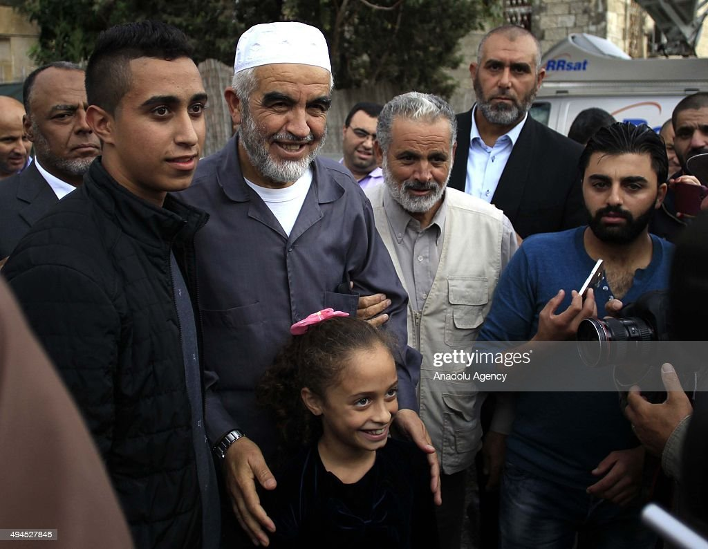 Sheikh Raed Salah (left 2), the leader of Islamic movement in the 1948 Palestine, are seen with the Palestinians supporting him after attending trial at the Jerusalem Regional Court on October 27, 2015. An Israeli court has sentenced Sheikh Raed Salah to 11 months in jail on charges of 'incitement'.