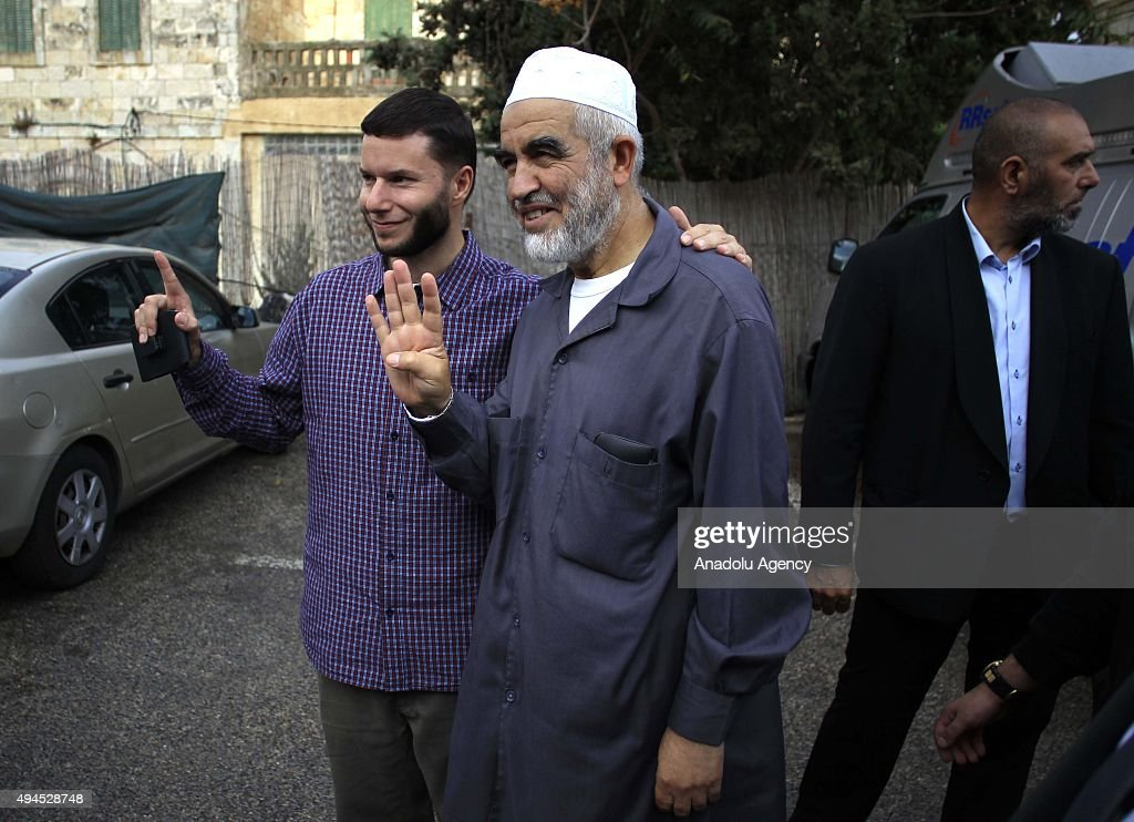 Sheikh Raed Salah (C), the leader of Islamic movement in the 1948 Palestine, are seen with the Palestinians supporting him after attending trial at the Jerusalem Regional Court on October 27, 2015. An Israeli court has sentenced Sheikh Raed Salah to 11 months in jail on charges of 'incitement'.