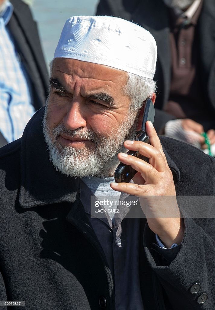 Sheikh Raed Salah, the leader of the radical northern wing of the Islamic Movement in Israel, talks on the phone following a prayer in support for the release of Mohammed al-Qiq, a Palestinian prisoner on hunger strike, outside the hospital where he is being treated in the northern Israeli town of Afula on February 12, 2016. Ailing Palestinian journalist Qiq will keep up his ten-week hunger strike despite Israel suspending a detention without trial order against him, his lawyer said. / AFP / JACK GUEZ