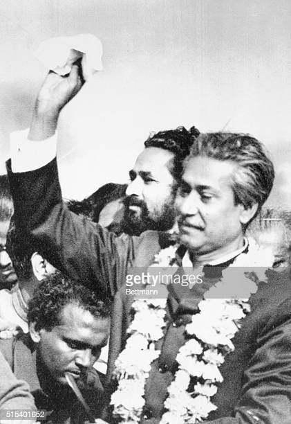 Sheikh Returns Dacca Bangladesh Sheikh Mujibur Rahman waves handkerchief in the air as he came home January 10 to Bangladesh the nation he had...
