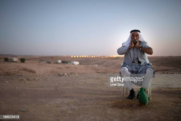 Sheikh Sayah Al Turi washes his face on October 9 2013 in the Bedouin village of AlArakib Israel Roughly 200000 Bedouins live in the Negev desert...