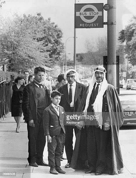 Sheikh Sulaiman Daher from the borders of Muscat and Bahrein waits at a bus stop in London with some of his relatives The Sheikh with a party of...