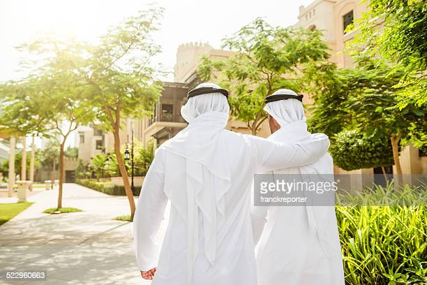 sheikh talking and walking togetherness on the city