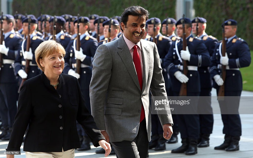 Sheikh Tamim bin Hamad Al Thani, the eighth and current Emir of the State of Qatar (R), attends a military welcome ceremony with German Chancellor Angela Merkel at the federal Chancellery on September 17, 2014 in Berlin, Germany. The Qatari monarch, known for his support of sporting events and his position as head of the Qatar Investment Authority board of directors, is visiting Berlin and Bavaria on his trip to the country.