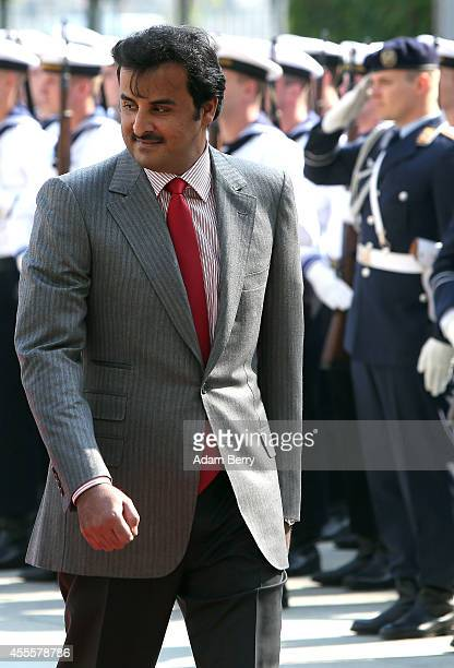 Sheikh Tamim bin Hamad Al Thani the eighth and current Emir of the State of Qatar arrives for a military welcome ceremony at the federal Chancellery...