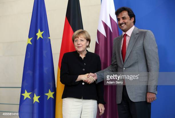Sheikh Tamim bin Hamad Al Thani the eighth and current Emir of the State of Qatar shakes hands with German Chancellor Angela Merkel after a press...