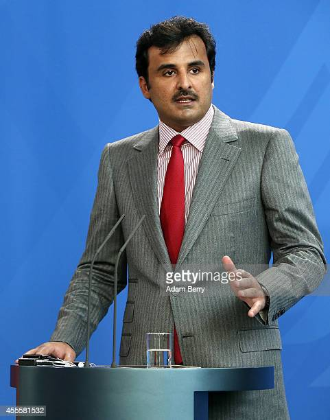 Sheikh Tamim bin Hamad Al Thani the eighth and current Emir of the State of Qatar speaks at a press conference with German Chancellor Angela Merkel...