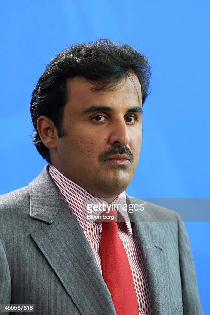 Sheikh Tamim bin Hamad Al Thani the Emir of Qatar pauses during a news conference at the Chancellery in Berlin Germany on Wednesday Sept 17 2014...