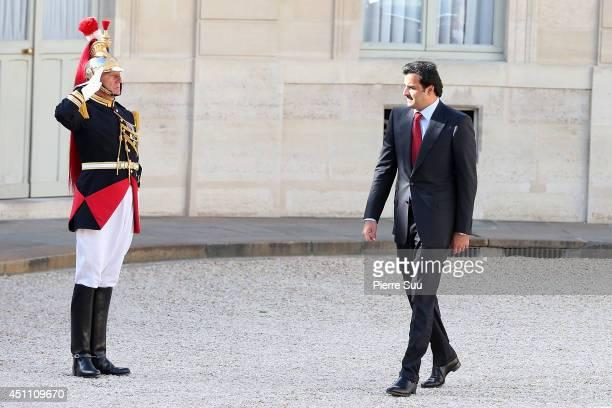 Sheikh Tamim Bin Hamad AlThani Emir of Qatar arrives at Elysee Palace on June 23 2014 in Paris France
