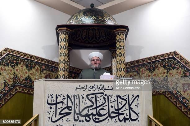 Sheikh Yahya Safi imam of Lekamba mosque gives a sermon after an Eid alFitr prayer at the Lekamba mosque in western Sydney on June 25 2017 Australian...